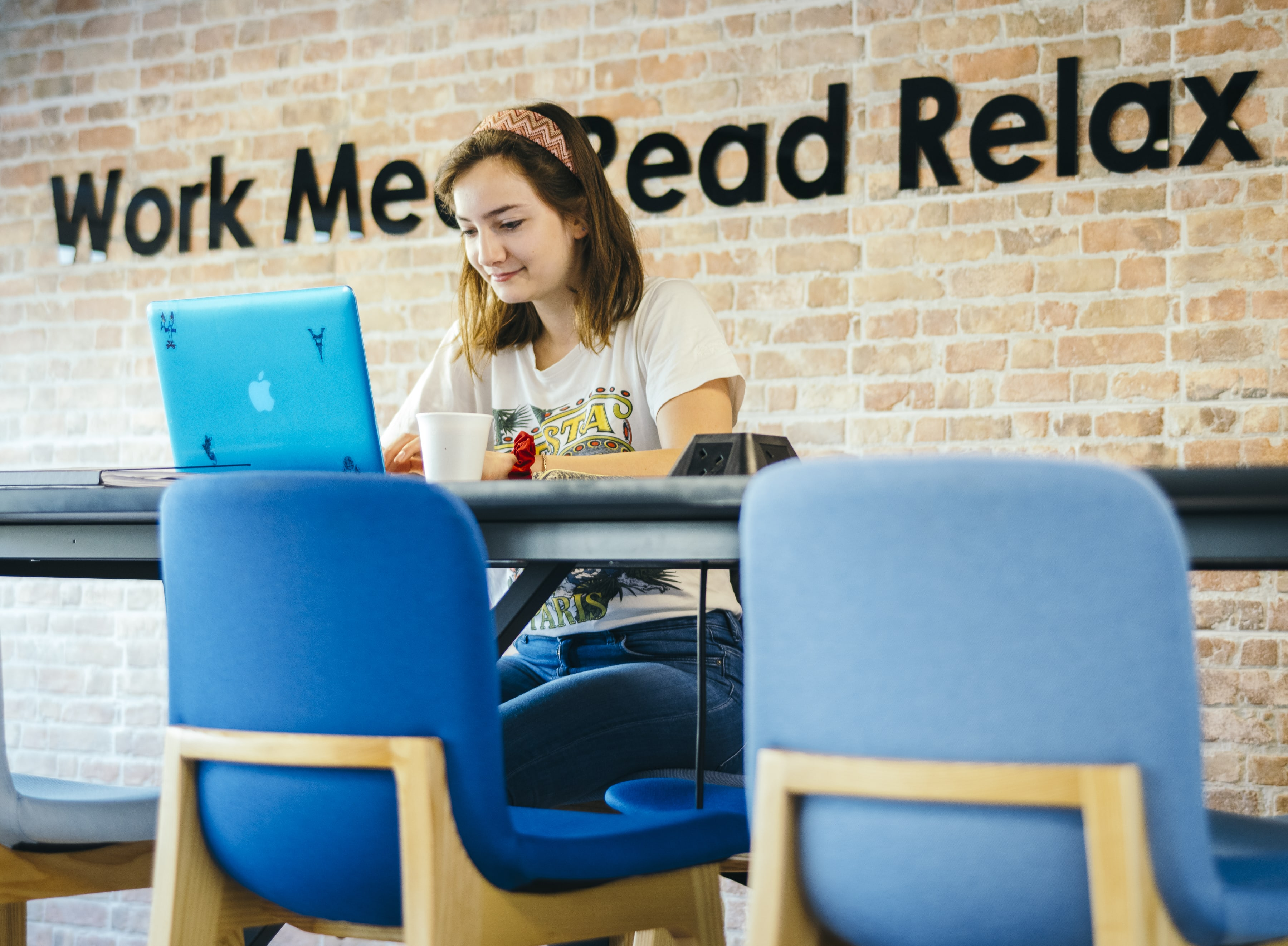Image of a person working in a co-working environment